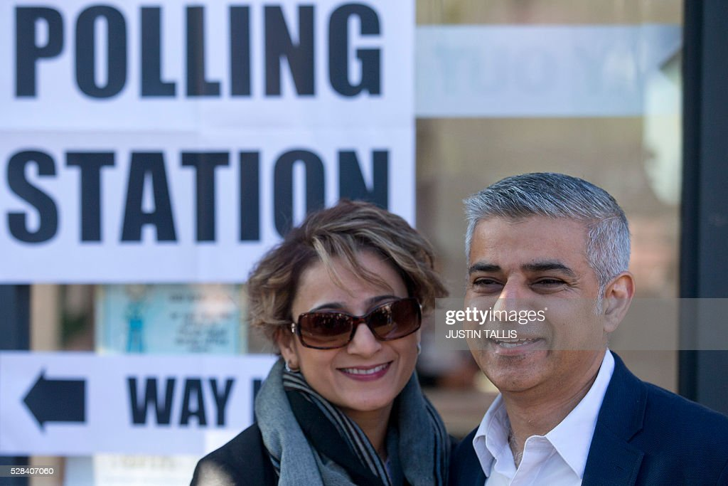 Britain's Labour party candidate for London Mayor Sadiq Khan and his wife Saadiya pose for photographers as they leave a Polling Station in south...