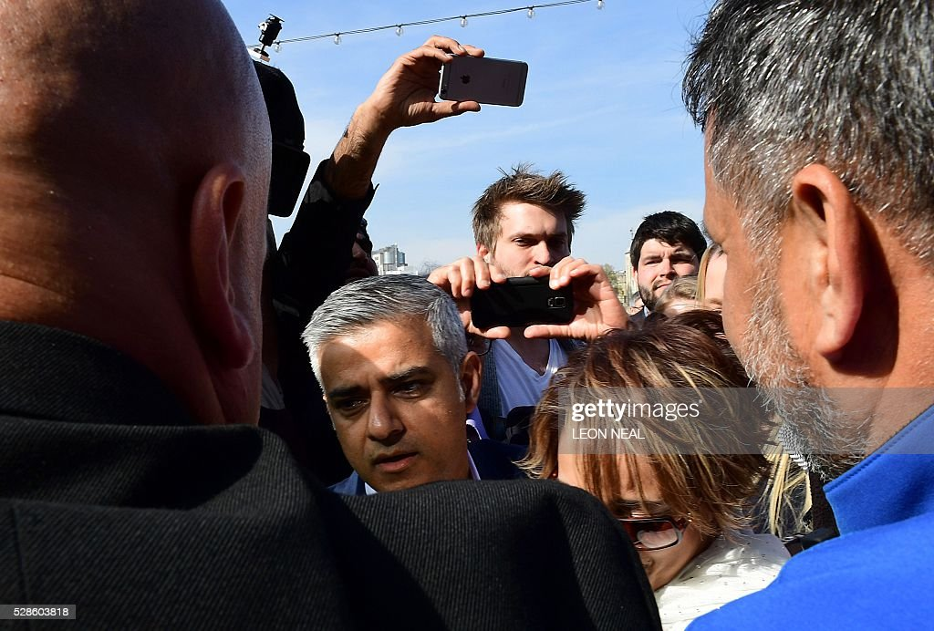 Britain's Labour party candidate for London Mayor Sadiq Khan (Below L) arrives at City Hall in central London on May 6, 2016, as votes continue to be counted in the contest for the Mayor of London. London was poised to become the first EU capital with a Muslim mayor Friday as Sadiq Khan took the lead in elections that saw his opposition Labour party suffer nationwide setbacks. / AFP / LEON