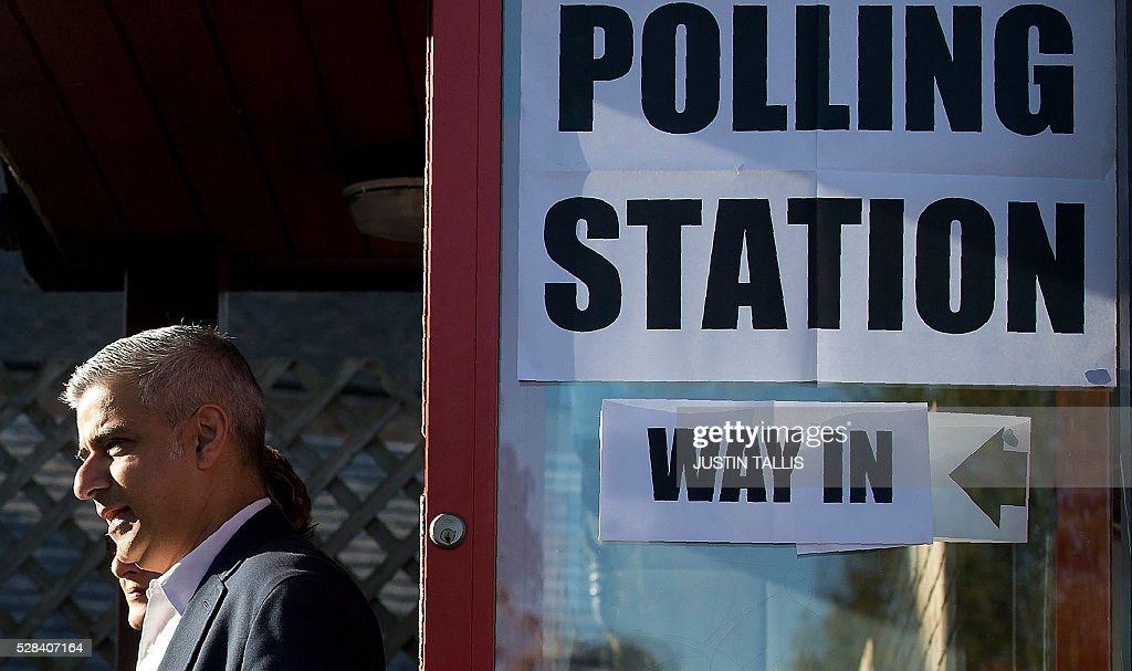 Britain's Labour party candidate for London Mayor Sadiq Khan leaves a Polling Station in south London on May 5, 2016, after casting his vote. Londoners go to the polls on Thursday to elect their new mayor following a bitter campaign between the two leading candidates Khan, and Conservative Zac Goldsmith, that stayed ugly to the very end. / AFP / JUSTIN