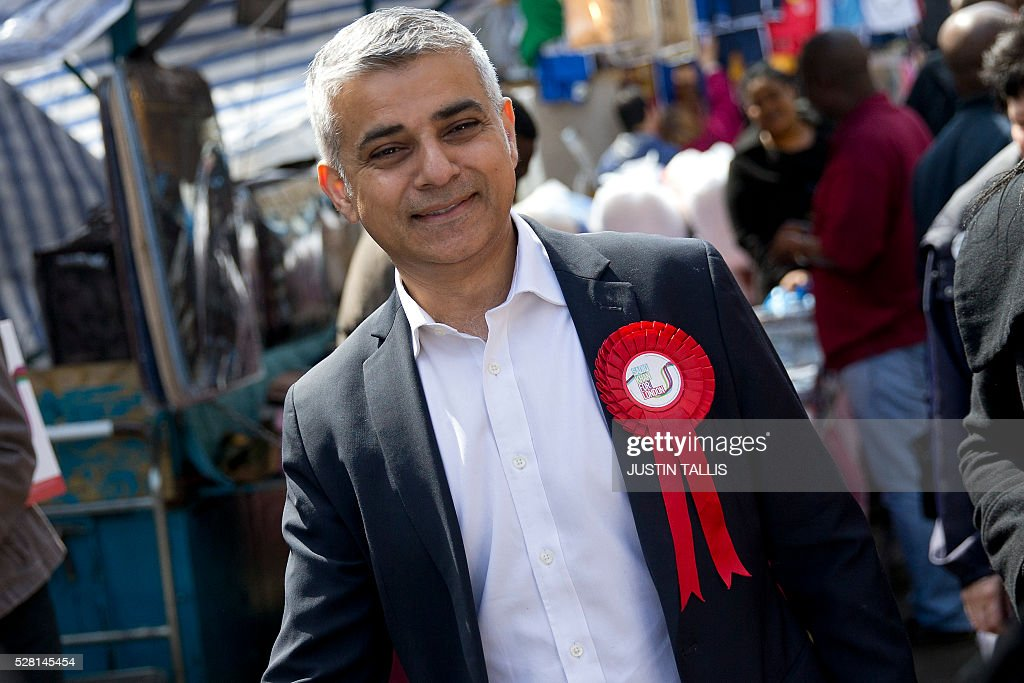 Britain's Labour party candidate for London Mayor Sadiq Khan reacts ashe canvasses for supporters at a market in London on May 4, 2016, on the eve of the London mayoral elections. Londoners choose their new mayor on May 5, 2016, after a straight fight between rival candidates Zac Goldsmith and Sadiq Khan dominated by negative campaigning. / AFP / JUSTIN