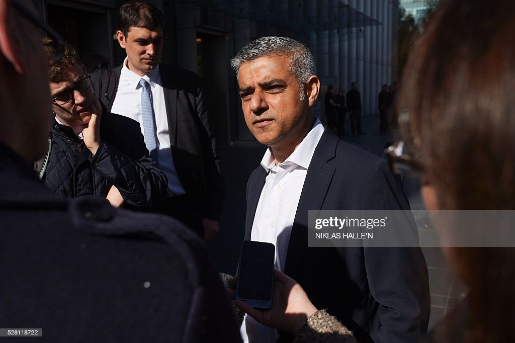 Britain's Labour party candidate for London Mayor Sadiq Khan speaks to members of the media after unveiling a poster campaign in Canary Wharf, east London on May 4, 2016, on the eve of the London mayoral elections. Londoners choose their new mayor on May 5, 2016, after a straight fight between rival candidates Zac Goldsmith and Sadiq Khan dominated by negative campaigning. / AFP / NIKLAS HALLE'N