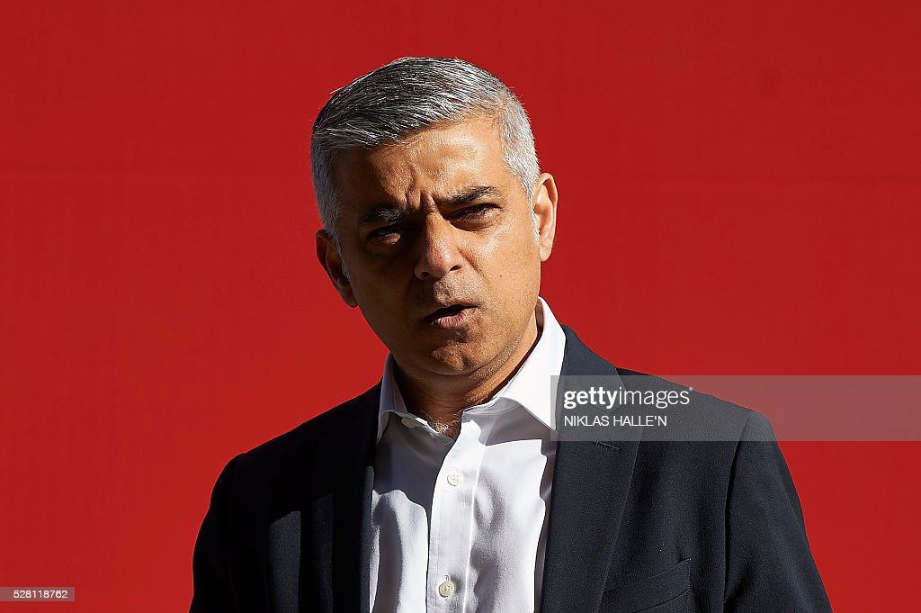 Britain's Labour party candidate for London Mayor Sadiq Khan unveils a poster campaign in Canary Wharf, east London on May 4, 2016, on the eve of the London mayoral elections. Londoners choose their new mayor on May 5, 2016, after a straight fight between rival candidates Zac Goldsmith and Sadiq Khan dominated by negative campaigning. / AFP / NIKLAS HALLE'N