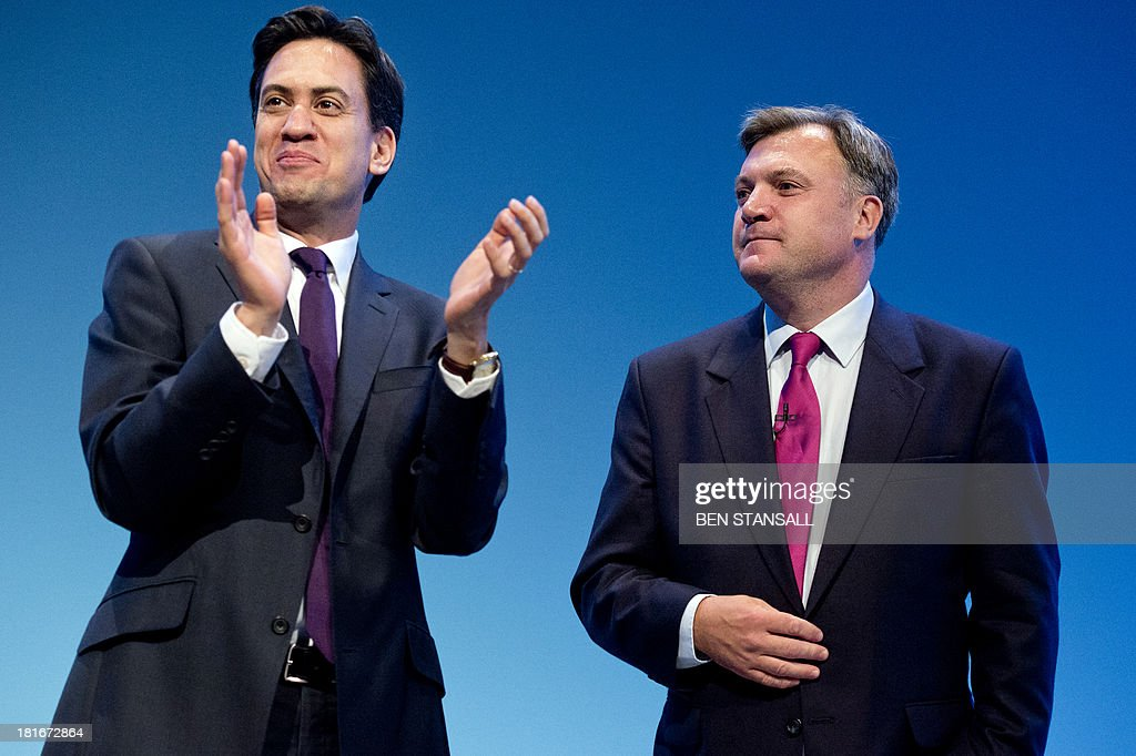 Britain's Labour party leader Ed Miliband (L) applauds shadow chancellor Ed Balls (R) following his speech on the second day of the Labour party conference in Brighton, Sussex, south England on September 23, 2013. Britain's main opposition Labour party kicked off its annual conference on September 22 with leader Ed Miliband under pressure amid sliding poll ratings 18 months before a general election.AFP PHOTO / BEN STANSALL