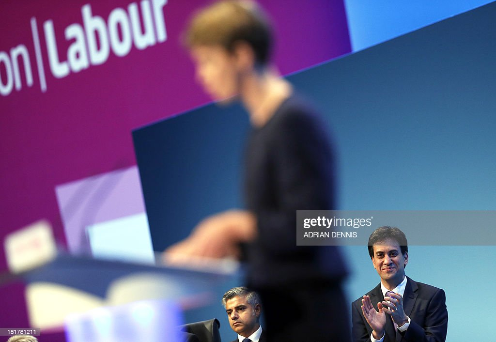 Britain's Labour Party leader Ed Miliband applauds Shadow Home Secretary Yvette Cooper as she speaks during the final day of the Labour party conference in Brighton, east Sussex, south England, on September 25, 2013.