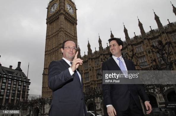 Britain's Labour party leader Ed Miliband walks with French presidential candidate Francois Hollande prior to their meeting at the Houses of...