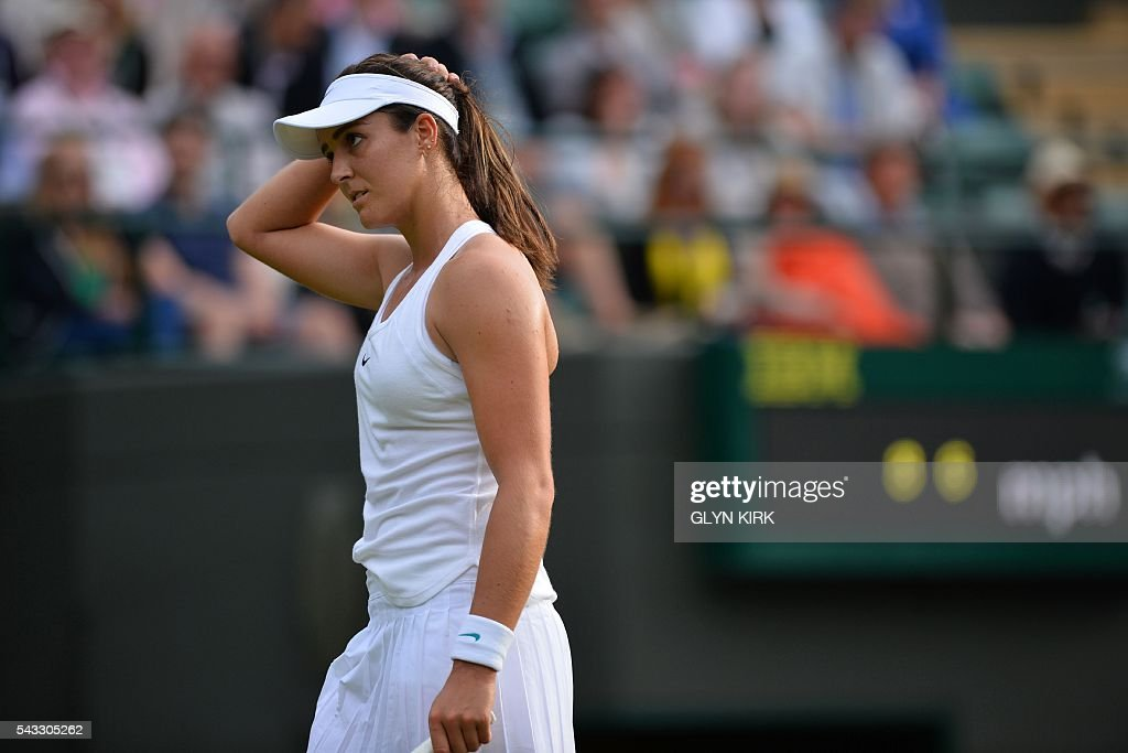 Britain's Laura Robson reacts after a point against Germany's Angelique Kerber during their women's singles first round match on the first day of the 2016 Wimbledon Championships at The All England Lawn Tennis Club in Wimbledon, southwest London, on June 27, 2016. / AFP / GLYN