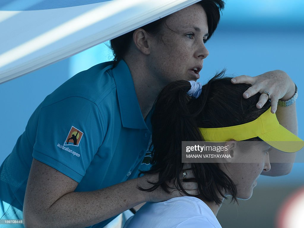 Britain's Laura Robson receives treatment during her women's singles match against Sloane Stephens of the US on the sixth day of the Australian Open tennis tournament in Melbourne on January 19, 2013. AFP PHOTO/MANAN VATSYAYANA IMAGE STRICTLY RESTRICTED TO EDITORIAL USE - STRICTLY NO COMMERCIAL USE
