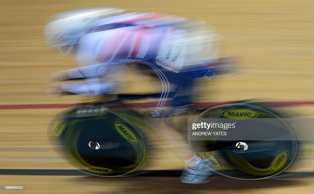 Britains' Laura Trott competes in the women's omnium individual pursuit during the final day of the Track Cycling World Cup at The National Cycling Centre in Manchester, north-west England on November 3, 2013. AFP PHOTO/ANDREW YATES