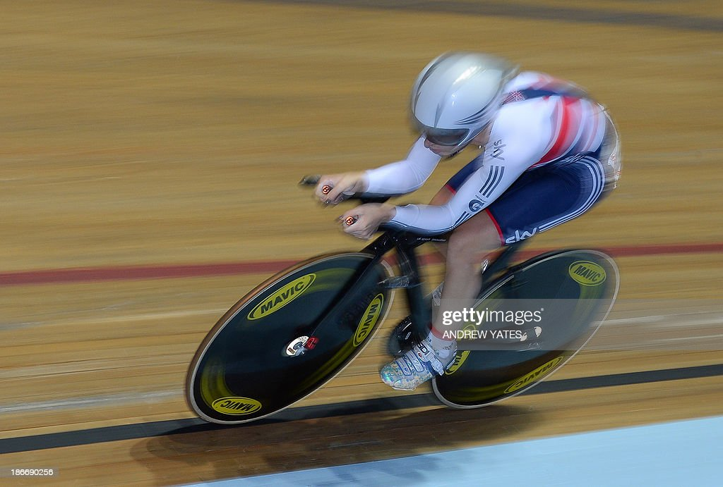 Britains' Laura Trott competes in the women's omnium individual pursuit during the final day of the Track Cycling World Cup at The National Cycling Centre in Manchester, north-west England on November 3, 2013.