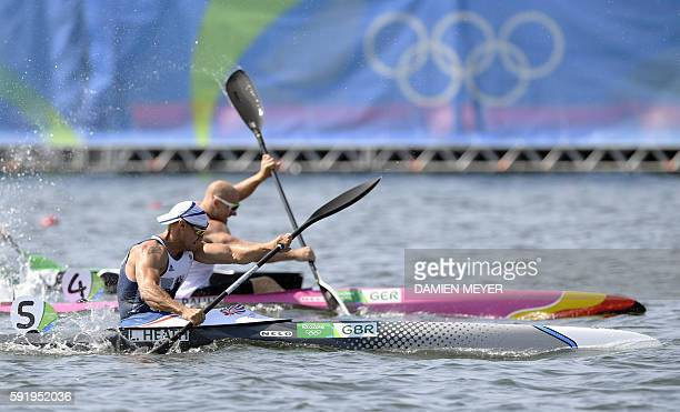 Britain's Liam Heath competes ahead of Germany's Ronny Rauhe in the Men's Kayak Single 200m event at the Lagoa Stadium during the Rio 2016 Olympic...