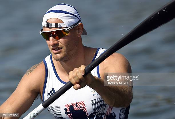 Britain's Liam Heath paddles after competing in the Men's Kayak Single 200m semifinal at the Lagoa Stadium during the Rio 2016 Olympic Games in Rio...