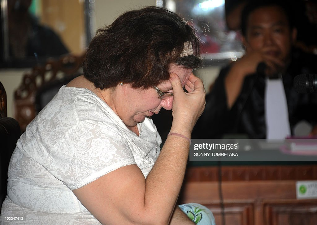 Britain's Lindsay June Sandiford (L), 56, gestures as she attends her trial at a court in Denpasar on the Indonesian resort island of Bali on October 4, 2012. Sandiford's trial, who is accused of smuggling five kilogrammes (11 pounds) of cocaine into Indonesia, opened on September 27 but was adjourned because she was not accompanied by a lawyer. The 56-year-old Briton was arrested in May on arrival at the Denpasar airport on the resort island of Bali after the drug was allegedly found in her bag.