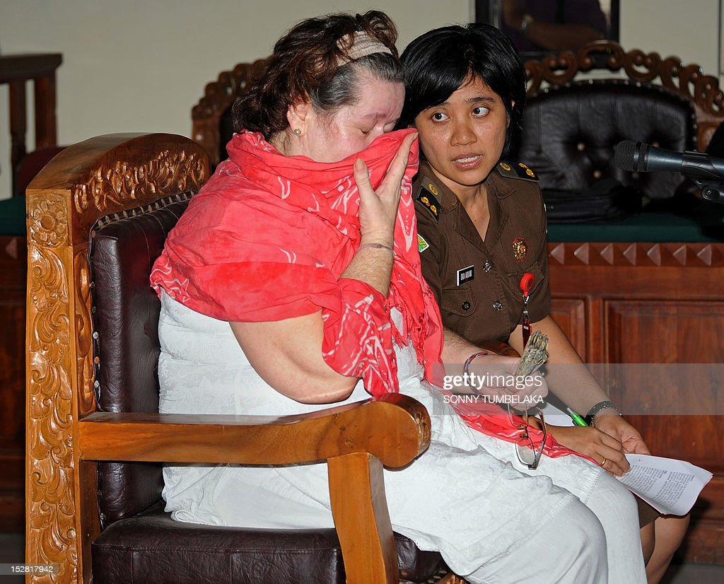 Britain's Lindsay June Sandiford (L), 56, wipes her face during her trial at a court in Denpasar on Indonesia's resort island of Bali on september 27, 2012. Sandiford was arrested on May 19 allegedly carrying 4.7 kilograms of cocaine in her luggage at Bali International Airport.