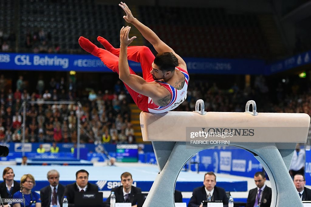 Britains Louis Smith falls as he performs during the Mens Pommel Horse competition of the European Artistic Gymnastics Championships 2016 in Bern, Switzerland on May 29, 2016. / AFP / FABRICE