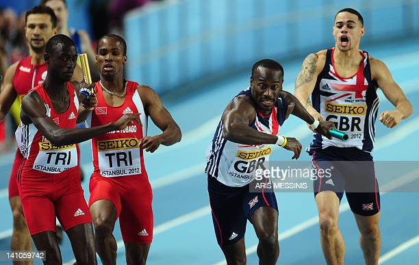 Britain's Luke LennonFord hands off the baton to team mate Michael Bingham as Trinidad and Tobago's Renny Quow hands off to his team mate Jereem...