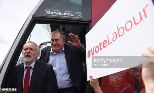 Britain's main opposition Labour Party leader Jeremy Corbyn and Labour's former deputy Prime Minister John Prescott exit the party's general election...