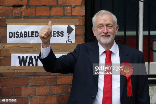 Britain's main opposition Labour Party leader Jeremy Corbyn arrives at a polling station to cast his vote in north London on June 8 as Britain holds...
