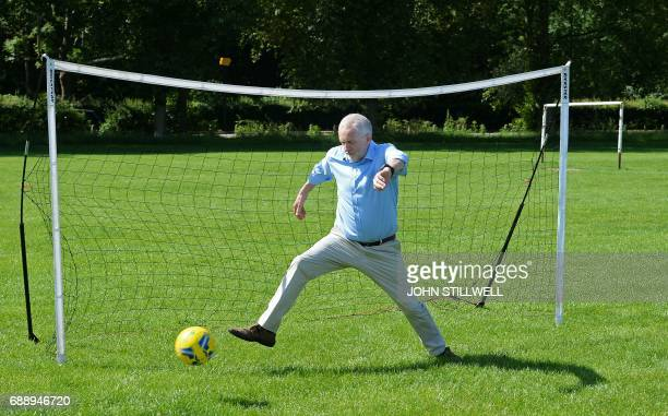 Britain's main opposition Labour party leader Jeremy Corbyn concedes a goal as he plays football with children during a visit to Hackney Marshes...