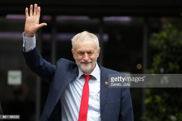 Britain's main opposition Labour Party leader Jeremy Corbyn gestures as he leaves an event entitled Ideas to Change Britain at the Cooperative Party...