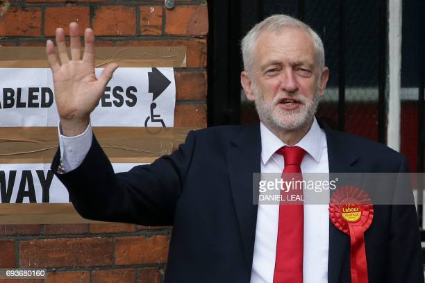 Britain's main opposition Labour Party leader Jeremy Corbyn gives a wave as he arrives at a polling station to cast his vote in north London on June...