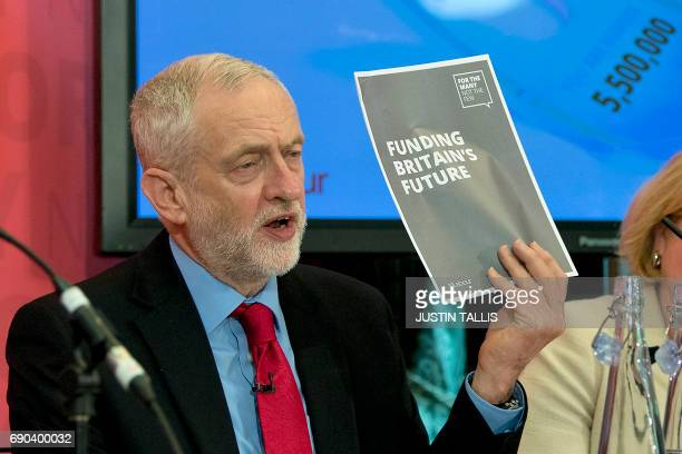 Britain's main opposition Labour party leader Jeremy Corbyn hosts a press conference during a general election campaign event in London on May 31 as...