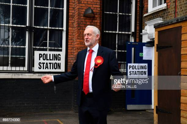Britain's main opposition Labour Party leader Jeremy Corbyn is pictured at a polling station to cast his vote in north London on June 8 as Britain...