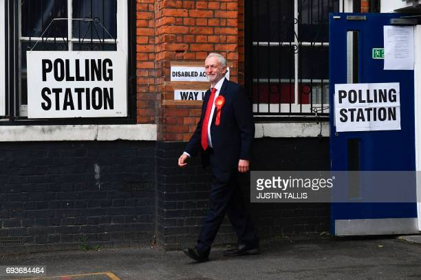 Britain's main opposition Labour Party leader Jeremy Corbyn leaves a polling station after casting his vote in north London on June 8 as Britain...