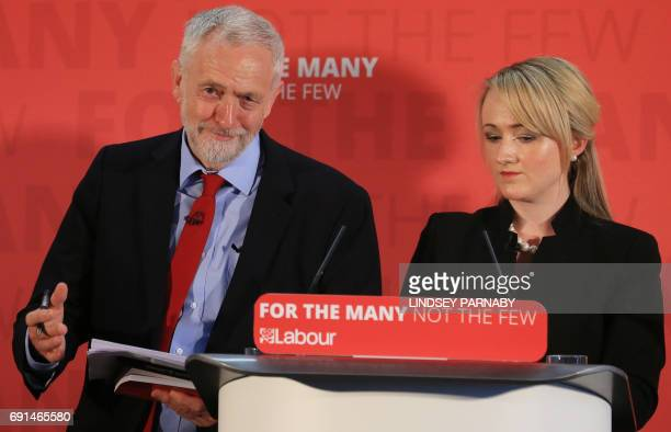 Britain's main opposition Labour Party leader Jeremy Corbyn shares the podium with Labour candidate for Salford and Eccles Rebecca LongBailey shadow...