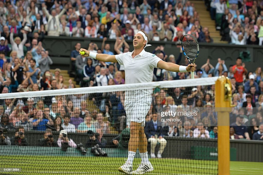 Britain's Marcus Willis celebrates winning his first game of the match in the second set against Switzerland's Roger Federer in their men's singles second round match on the third day of the 2016 Wimbledon Championships at The All England Lawn Tennis Club in Wimbledon, southwest London, on June 29, 2016. / AFP / GLYN