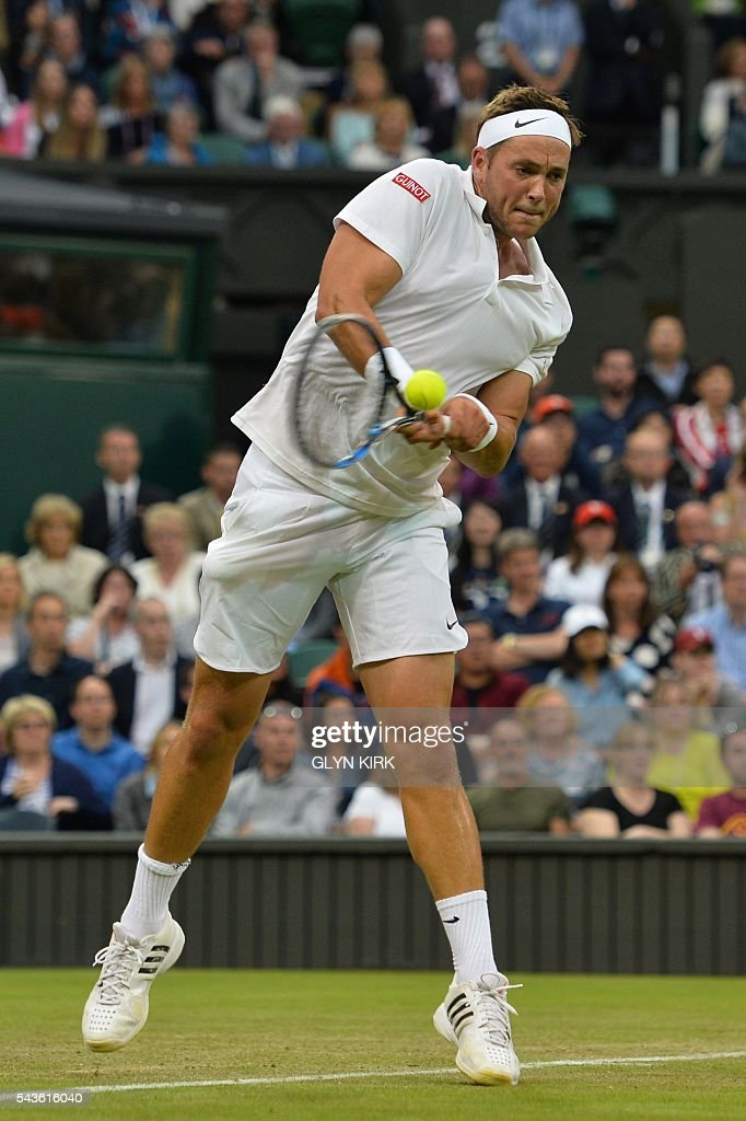 Britain's Marcus Willis returns against Switzerland's Roger Federer in their men's singles second round match on the third day of the 2016 Wimbledon Championships at The All England Lawn Tennis Club in Wimbledon, southwest London, on June 29, 2016. / AFP / GLYN