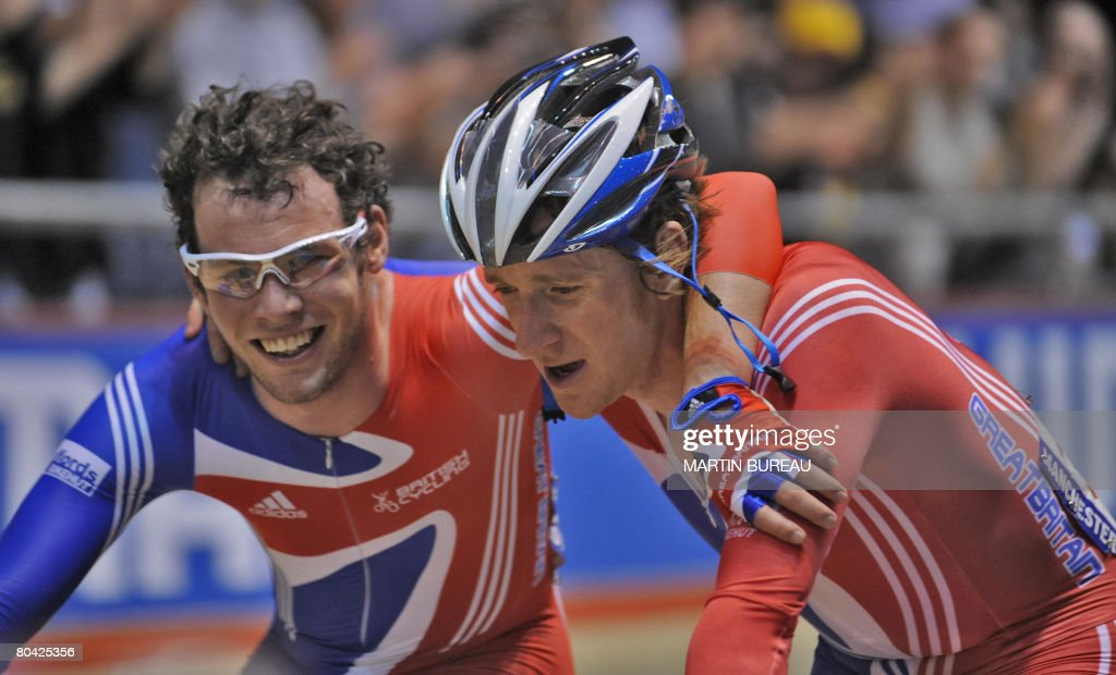 Britain's Mark Cavendish celebrates with his compatriot Bradley Wiggins their victory in the men's Madison finals in the UCI Track Cycling World...