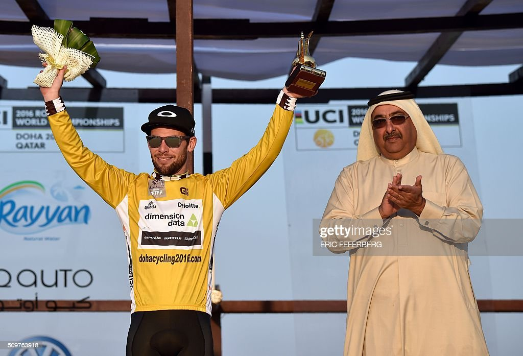 Britain's Mark Cavendish (L) of Dimension Data team celebrates his overall gold jersey on the podium of the 5th and last stage of the 15th Tour of Qatar on February 12, 2016, in Qatar. / AFP / ERIC FEFERBERG