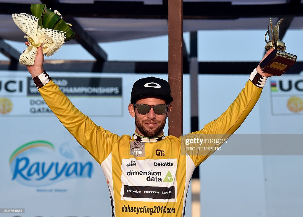 Britain's Mark Cavendish of Dimension Data team celebrates his overall gold jersey on the podium of the 5th and last stage of the 15th Tour of Qatar on February 12, 2016, in Qatar. / AFP / ERIC FEFERBERG
