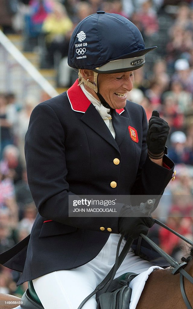 Britain's Mary King gestures as she celebrates while competing on Imperial Cavalier in the team Show Jumping phase of the Eventing competition of the 2012 London Olympics at the Equestrian venue in Greenwich Park, London on July 31, 2012.
