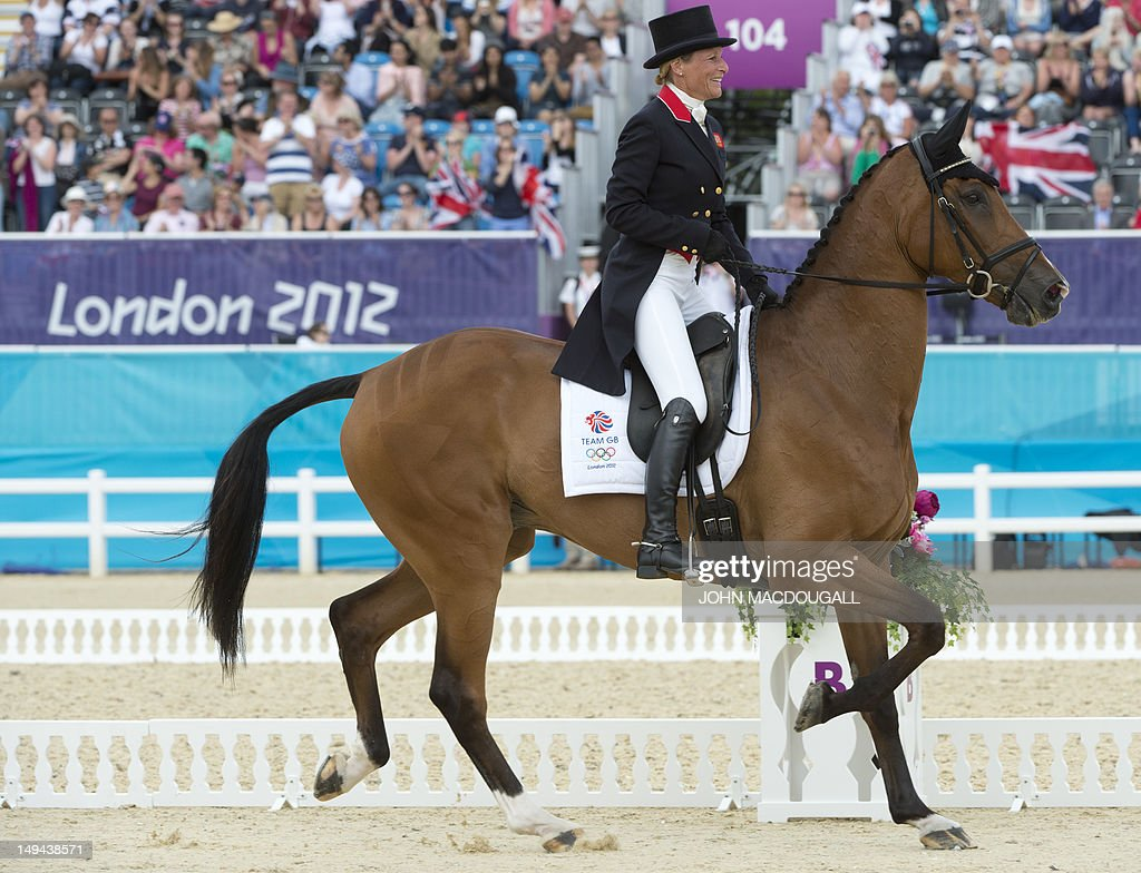 Britain's Mary King on Imperial Cavalier celebrates after competing in the Dressage event of the Eventing competition of the 2012 London Olympics at the Equestrian venue in Greenwich Park, London, July 28, 2012.
