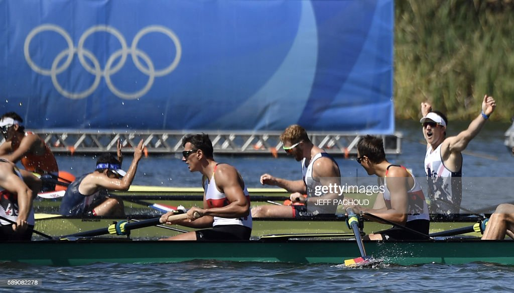 Britain's Matt Langridge (R) celebrates after winning the Men's Eight final rowing competition at the Lagoa stadium during the Rio 2016 Olympic Games in Rio de Janeiro on August 13, 2016. / AFP PHOTO / Jeff PACHOUD / The erroneous mention[s] appearing in the metadata of this photo by Jeff PACHOUD has been modified in AFP systems in the following manner: [Britain's Matt Langridge (R)] instead of [Britain's Paul Bennett (R)]. Please immediately remove the erroneous mention[s] from all your online services and delete it (them) from your servers. If you have been authorized by AFP to distribute it (them) to third parties, please ensure that the same actions are carried out by them. Failure to promptly comply with these instructions will entail liability on your part for any continued or post notification usage. Therefore we thank you very much for all your attention and prompt action. We are sorry for the inconvenience this notification may cause and remain at your disposal for any further information you may require.
