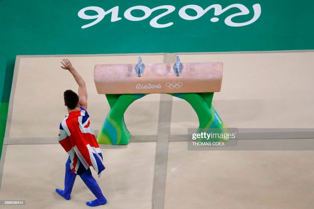 TOPSHOT - Britain's Max Whitlock celebrates winning the men's pommel horse event final of the Artistic Gymnastics at the Olympic Arena during the Rio 2016 Olympic Games in Rio de Janeiro on August 14, 2016. / AFP / Thomas COEX