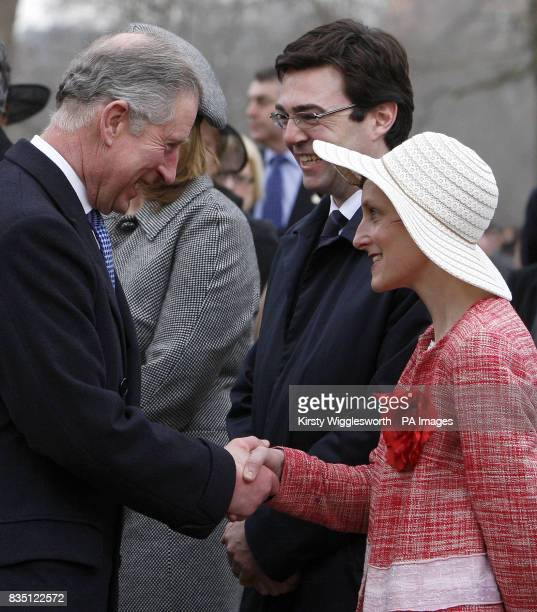 Britain's Minister for Culture Media and Sport Andy Burnham centre looks on as his wife MarieFrance right shakes hands with Prince Charles during the...