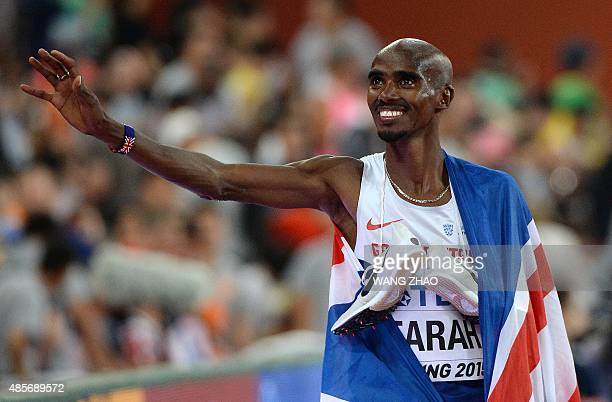 Britain's Mo Farah celebrates winning the final of the men's 5000 metres athletics event at the 2015 IAAF World Championships at the 'Bird's Nest'...