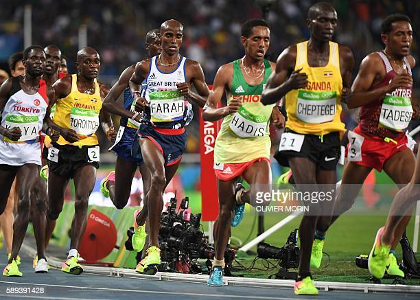 TOPSHOT Britain's Mo Farah competes in the Men's 10000m during the athletics event at the Rio 2016 Olympic Games at the Olympic Stadium in Rio de...