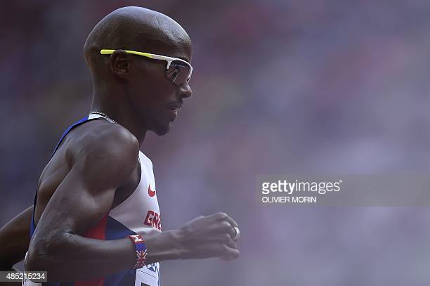 Britain's Mo Farah competes in the men's 5000 metres athletics event at the 2015 IAAF World Championships at the 'Bird's Nest' National Stadium in...