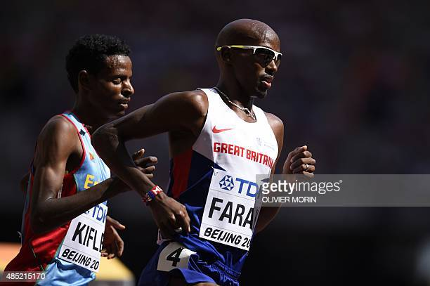 Britain's Mo Farah leads a heat during the men's 5000 metres athletics event at the 2015 IAAF World Championships at the 'Bird's Nest' National...