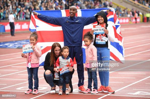 Britain's Mo Farah poses with his family after winning the men's 3000m during the 2017 IAAF Birmingham Diamond League athletics meeting at Alexander...