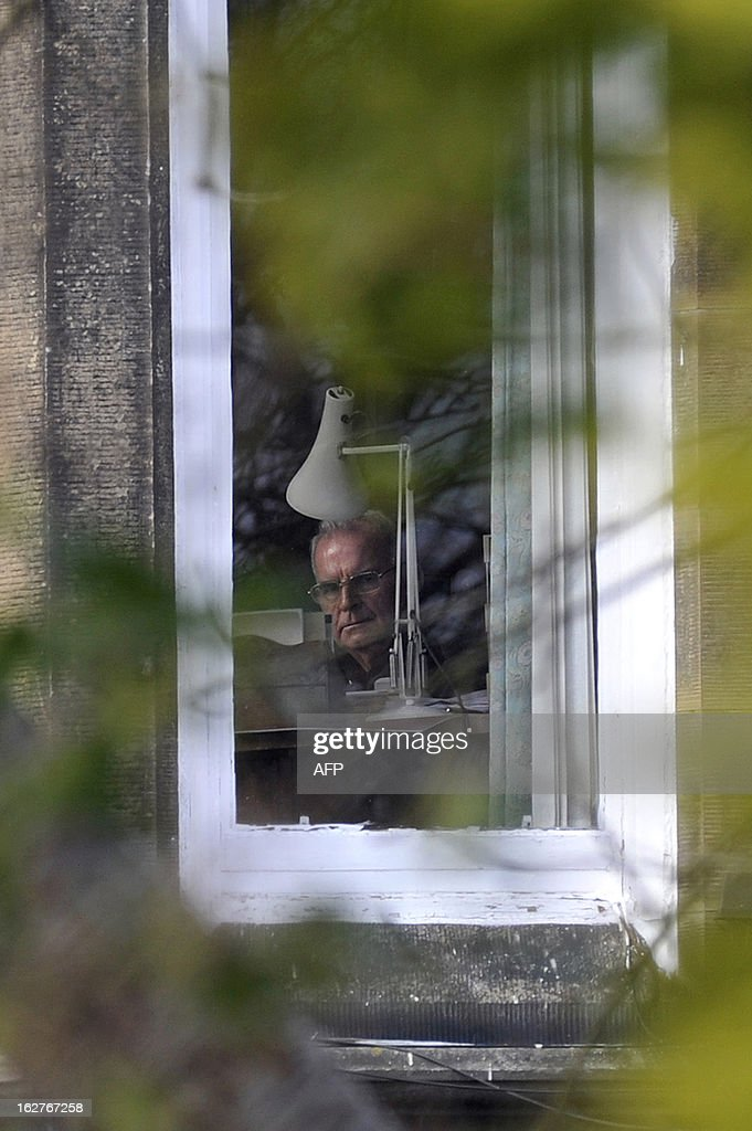 Britain's most senior Roman Catholic cleric Cardinal Keith O'Brien looks out of a window at his home in Edinburgh, Scotland, on February 26, 2013. O'Brien resigned with immediate effect Monday in the wake of allegations of inappropriate behaviour. O'Brien, who as Archbishop of St Andrews and Edinburgh was leader of the Catholic Church in Scotland, denies allegations that he made sexual advances towards priests in the 1980s.