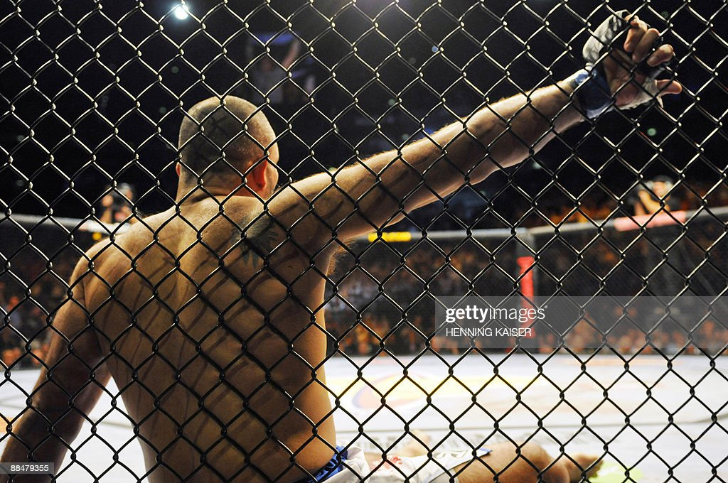 Britain's Mustapha AlTurk rests against the cage after Croatia's Mirko Cro Cop knocked him out at the 'Mixed Martial Arts' cage fighting event in the...