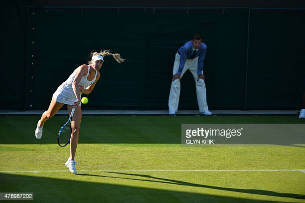 Britain's Naomi Broady serves to Colombia's Mariana DuqueMarino during their women's singles first round match on day one of the 2015 Wimbledon...