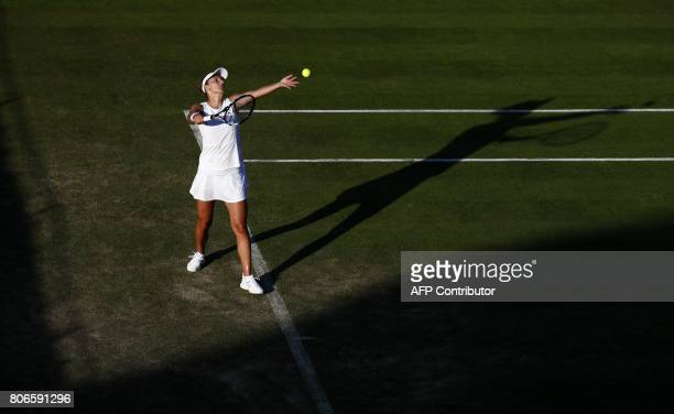 Britain's Naomi Broady throws the ball to serve against Romania's Irina Begu during their women's singles first round match on the first day of the...