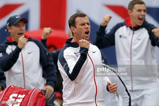 Britain's national tennis team captain Leon Smith reacts after Britain's Kyle Edmund scored a point against Serbia's Dusan Lajovic during the Davis...