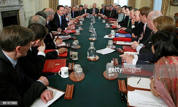 Britain's new Conserative Party Prime Minister David Cameron chairs the first Cabinet meeting of the new Conservative/Liberal Democrat coalition...