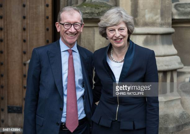 Britain's new Conservative Party leader Theresa May poses for a photograph with her husband Philip John May before she speaks to members of the media...